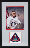 Explorers:Space Exploration, Frank Borman Signed White Spacesuit Color Photo Matted and Framed with an Embroidered Mission Patch. ...