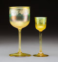 Glass, Two Tiffany Studios Etched Gold Favrile Glass Stems, circa 1910. Marks: LCT, Favrile, (various). 5-3/4 inches (14.6 cm) ... (Total: 2 Items)