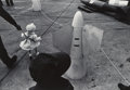 Photographs, Ken Graves (American, 1945-2016). Toddler Among Ballistic Missiles at Naval Base. Gelatin silver. 5-3/8 x 7-7/8 inches (...