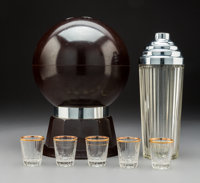 American Art Deco Chrome and Glass Cocktail Set in Bakelite Bowling Ball-Form Musical Case, circa 1940 Marks to case lid...