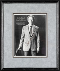 """Clint Eastwood Lot (1985). Very Fine. Framed and Autographed Magazine Page (15"""" X 18"""") & Framed Tv Ad..."""
