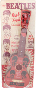 Music Memorabilia:Memorabilia, The Beatles Yeah Yeah Vintage Toy Guitar by Mastro on Reproduction Display Card and Instruction Book (Guitar, NEMS, 1964). ...