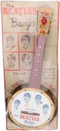 Music Memorabilia:Memorabilia, The Beatles Toy Banjo on Backing Card And Instruction Booklet (Reproduction)....