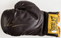Autographs:Others, Mike Tyson Signed Retro Everlast Boxing Glove....