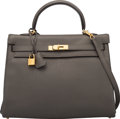 """Luxury Accessories:Bags, Hermès 35cm Etain Clemence Leather Retourne Kelly Bag with Gold Hardware. X, 2016. Condition: 3. 14"""" Width x 10"""" H..."""