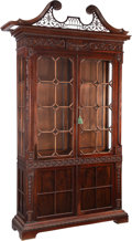 Furniture, A Fine English Chippendale-Style Carved Mahogany Bookcase, early 20th century. 100 x 52 x 16 inches (254 x 132.1 x 40.6 cm)...