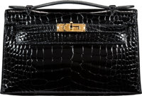 "Hermès Shiny Black Alligator Kelly Pochette Bag with Gold Hardware A, 2017 Condition: 1 8.5"" Width x 5""..."