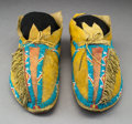 American Indian Art:Beadwork and Quillwork, A Pair of Kiowa Beaded Hide Moccasins... (Total: 2 )