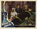 "Movie Posters:Horror, House of Dracula (Universal, 1945). Lobby Card (11"" X 14""). In oneof the best cards from the set, Lon Chaney, Jr. watches a..."