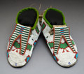 American Indian Art:Beadwork and Quillwork, A Pair of Blackfoot Beaded Hide Moccasins... (Total: 2 )