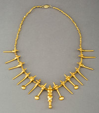 A Necklace with Gold Beads and Pendants
