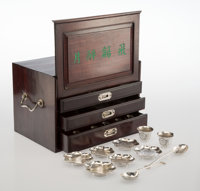 A Fifty-Three-Piece Chinese Bright Cut Silver Condiment Service with Bat Decoration in a Hung Ma Wood Case, early 20t