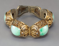 A Suite of Chinese Filigree Gilt Silver and Coral Jewelry with a Similar Jadeite-Set Bracelet, circa 1920 Marks: o