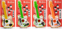 The Beatles Set of Four Plastic Miniature Guitars on Backing Cards