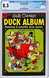 Four Color #560 Duck Album (Dell, 1954) CGC VF+ 8.5 White pages