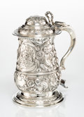 Silver & Vertu, A William Homer Repoussé Silver Covered Tankard, London, 1760. Marks: (lion passant), (crowned leopard's head), E, W· (p...