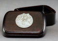 Carvings, A Chinese White Jade Disk Set in a Hardwood Box. 2-7/8 x 5-5/8 x 3-3/4 inches (7.3 x 14.3 x 9.5 cm). ...