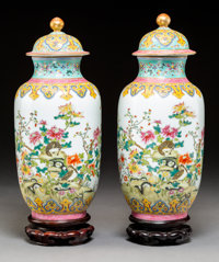 A Pair of Chinese Famille Rose Porcelain Vases with Covers, Republic Period Marks: Six-character Qianlong mark in ... (T...
