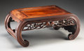 Furniture, A Chinese Carved Hardwood Kang Table, Qing Dynasty, 19th century . 10-7/8 x 25-3/4 x 14-7/8 inches (27.6 x 65.4 x 37.8 cm). ...