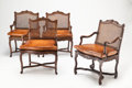 Furniture, A Set of Four Continental Louis XV-Style Walnut and Cane Armchairs and a Neoclassical-Style Dining Table, 20th century . 30-... (Total: 5 Items)