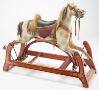 An American Carved and Painted Wood Rocking Horse, circa 1900 Marks: Mallable, Unbreakable 36 x 16-1