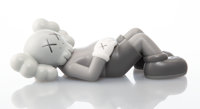 KAWS (b. 1974) Holiday: Japan (Grey), 2019 Painted cast vinyl 4 x 9-1/2 x 3-1/2 inches (10.2 x 24