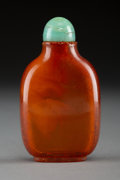 Carvings, A Chinese Amber Snuff Bottle, Qing Dynasty, 19th century. 2-5/8 x 1-1/2 x 0-3/4 inches (6.7 x 3.8 x 1.9 cm). ...