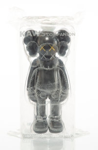 KAWS (b. 1974) Companion (Black), 2016 Painted cast vinyl 10-3/4 x 5 x 3-1/2 inches (27.3 x 12.7