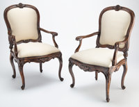 A Pair of Italian Carved Walnut Armchairs, 18th century 40-1/2 x 24 x 20-3/4 inches (102.9 x 61.0 x 52.7 cm)  ... (Total...