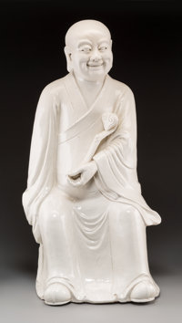 A Large Chinese Dehua Figure of a Luohan, Qing Dynasty 30-3/4 h x 15-1/2 w x 14-1/2 d inches (78.1 x 39.4 x 36.8 c