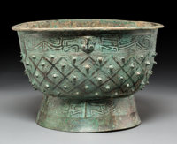 A Chinese Bronze Ritual Yu Food Vessel, late Shang-Western Zhou Dynasty 6-1/4 x 9-5/8 inches (15.9 x 24.4 cm) <...