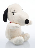 Collectible, KAWS X Peanuts. Snoopy, large, c. 2017. Polyester plush. 9 x 22 x 9 inches (22.9 x 55.9 x 22.9 cm). Incised on the colla...