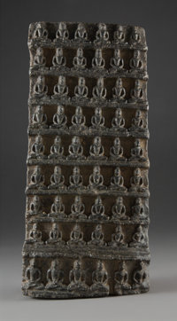 A Tibeto-Chinese Carved Stone Fifty-Four-Buddha Stele, pre-Ming Dynasty 12-3/4 x 6 x 2-1/2 inches (32.4 x 15.2 x 6