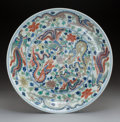 Ceramics & Porcelain, A Chinese Wucai Dragon and Phoenix Dish. Marks: Six-character Kangxi mark in underglaze blue. 1-1/2 x 10 inches (3.8 x 25.4 ...