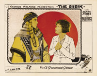 "The Sheik (Paramount, 1921). Lobby Card (11"" X 14""). The dark and brooding ""Sheik"" (Rudolph Valentin..."