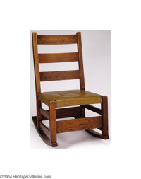 Gustave Stickley: AN AMERICAN ROCKING CHAIR (Gustave Stickley) Gustave Stickley, c.1900  The oak and leather seating has...