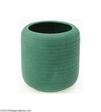 Teco: AN AMERICAN PRAIRIE SCHOOL ARTS & CRAFTS POTTERY VASE (Teco) Teco, c.1910  Grooved cylindrical form with soft...