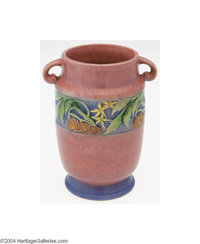 Roseville: A BANEDA PINK AMERICAN POTTERY MILK-CAN SHAPED VASE Roseville, c.1931  The pink matte ground with a sky blue...