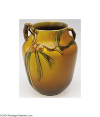Roseville: A PINE CONE BROWN AMERICAN POTTERY VASE Roseville, c.1931  With strong mold and color, the brown matte ground...