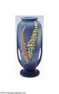 Roseville: A FOXGLOVE BLUE AMERICAN POTTERY VASE Roseville, c.1942  The deep blue matte glaze molded with yellow and pin...