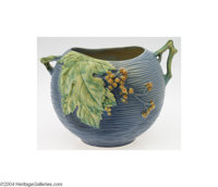Roseville: A BUSHBERRY BLUE AMERICAN POTTERY JARDINIERE (Roseville) Roseville, c.1941  With scissor cut top and handles...