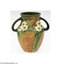 Roseville: A JONQUIL AMERICAN POTTERY VASE (Roseville) Roseville, c.1930  The textured brown matte glaze ground molded t...