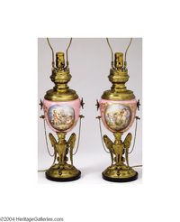 Sevres: A PAIR OF BRASS AND PORCELAIN LAMP BASES (Sevres) Sevres, c.1900  The pedestals with brass griffins supporting p...
