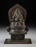 Metalwork, An Indian Bronze Figure of Seated Ganesha. 6-1/2 inches (16.5 cm). ...