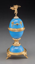 Ceramics & Porcelain, A Russian Gilt-Silver and Ceramic Egg-on-Stand with Ring Holder, 20th century. Marks: EK, (effaced marks). 8-1/2 x 3-1/2...