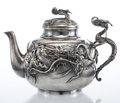Silver & Vertu, A Nomura Hammered and Repoussé Silver Dragon Teapot with Cover, Nagahama, Japan, Meiji Period, early 20th century . Marks: (...