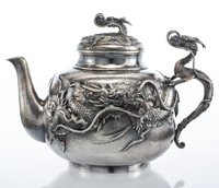 A Nomura Hammered and Repoussé Silver Dragon Teapot with Cover, Nagahama, Japan, Meiji Period, early 20th century
