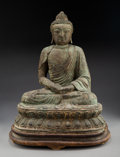 Metalwork, A Chinese Partial Gilt Bronze Figure of Seated Buddha Shakyamuni, late Ming Dynasty. 19-1/2 x 16 x 10-1/2 inches (49.5 x 40....