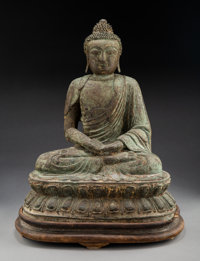 A Chinese Partial Gilt Bronze Figure of Seated Buddha Shakyamuni, Late Ming Dynasty 19-1/2 x 16 x 10-1/2 inches (4
