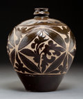 Ceramics & Porcelain, A Chinese Carved Ovoid Bottle, Northern Song Dynasty-Jin Dynasty. 9 x 8 inches (22.9 x 20.3 cm). ...